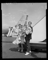 Singer Pat Boone with wife Shirley and their four children after disembarking plane in Los Angeles, Calif., 1959