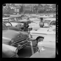 Mary Ann Harmon looking for her car in one of UCLA's packed parking lots, 1961