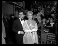 "Actors Tony Curtis and Janet Leigh with fans at film premiere of ""Pepe"" in Los Angeles, Calif., 1960"