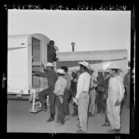 Plights of Americans and Braceros Compared:Mexican nationals board bus at labor camp in Long Beach, Calif., 1961