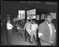 Saleman challenging pro-Castro marchers at Los Angeles Federal Building, Los Angeles, 1961