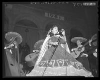 Rosa Michoacana sings in front of City Hall during Mexican Independence Day celebration in Los Angeles, Calif., 1961