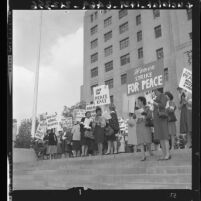 Women strike for peace, picket march in front of state building in Los Angeles, Calif., 1961