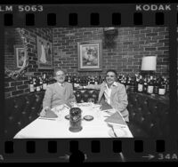 Restaurateurs, George Smith and Jimmy Ullo seated in booth at La Dolce Vita in Beverly Hills, Calif., 1976