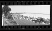 Wide angle view of Pacific Coast Highway and Santa Monica Beach, Calif., 1976