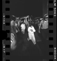 Sheriffs escorting rescued children of Chowchilla bus kidnapping, Calif., 1976
