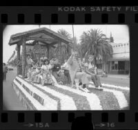 Chowchilla kidnapping bus driver Ed Ray and children riding on float in parade held in his honor in Chowchilla, Calif., 1976