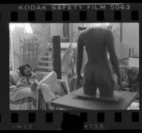 Robert Graham relaxing in his studio in Venice, Calif., 1976