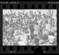 Henry Gibson speaking at rally of PACE (People, Access, Coastal Environment) in Santa Monica, Calif., 1976