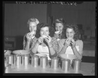 Women shown testing pears they are canning at Puente Canning Center, Calif., 1946