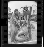 Jay Langham and Hugh Innes-Brown displaying great white shark that was caught off Southern California Coast, 1976