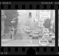Traffic passing empty bus lane along Spring Street during RTD transit strike in Los Angeles, Calif., 1976