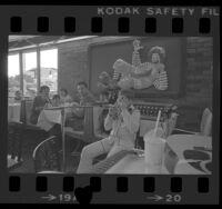 Twelve-year-old Rick Ludt playing Jew's harp at a McDonald's Big Mac Supper Club in Pasadena, Calif., 1976