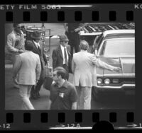 Viktor Ivanovich Belenko, Soviet defector, being led by decoy at Los Angeles International Airport, Calif., 1976