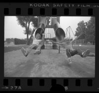Eric and Chad Eitner coming down playground slide in Studio City, Calif., 1976