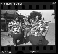 Wonder Woman, Lynda Carter in costume, with Benny and Billy McGuire in Los Angeles, Calif., 1976