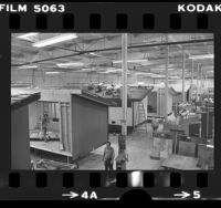 Workers building prefabricated houses in factory in Fountain Valley, Calif., 1976