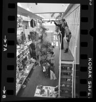 Donald J. Pliner with his wife Lois in his store on Rodeo Drive, Beverly Hills, Calif., 1976