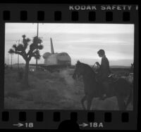 Boy on horseback watching the Space Shuttle Enterprise being towed across Antelope Valley, Calif., 1977