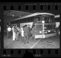Illegal aliens boarding U.S. Border Patrol bus in Los Angeles, Calif., 1977