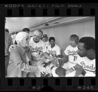 Lillian Carter, escorted by Tom Lasorda meeting players in Dodgers dugout, 1977