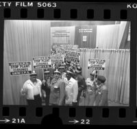 "United Auto Workers delegates with pickets reading ""Stop Plant Closings UAW-I.P.S."", Calif., 1977"