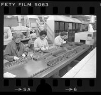 Three women working on semiconductor assemblies at International Rectifier Corp. in Los Angeles, Calif., 1977