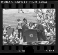 Mayor Tom Bradley taking oath of office from Chief Justice Rose Bird in Los Angeles, Calif., 1977