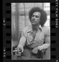 Huey P. Newton speaking with cigar in hand, 1977