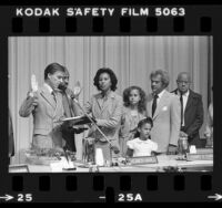 Yvonne Brathwaite Burke, with her family, being sworn in as Los Angeles County Supervisor by Jerry Brown, Calif., 1979