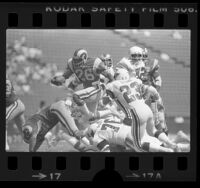 Wendell Tyler clearing tackle during Los Angeles Rams vs St. Louis Cardinals game, 1979
