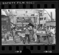 Flag carrying Sandinista sympathizers marching along dock in Terminal Island, Calif., 1979