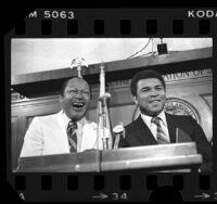 Mayor Tom Bradley and Muhammad Ali at podium in Los Angeles City Hall, 1979
