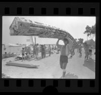 Jeff Carlson with his aluminum can and duct tape regatta entry at Long Beach Marine Stadium, Calif., 1979