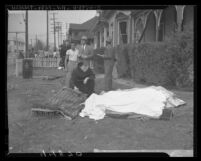 Father Bernardine administering last rites to victim of O'Connor Electro-Plating explosion in Los Angeles, Calif., 1947