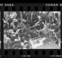 Crowd greeting Magic Johnson at Lakers NBA championship rally in Los Angeles, Calif., 1980