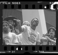 Magic Johnson wearing NBA championship t-shirt at Lakers rally in Los Angeles, Calif., 1980