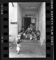 Skid Row children on door step of apartment building in Los Angeles, Calif., 1979