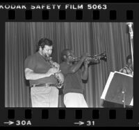 Ruben Leon and trumpet player performing in Black and Brown Brotherhood Band, Los Angeles, Calif., 1979