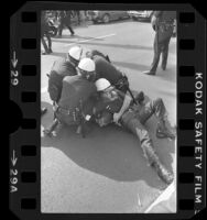 Police restraining Iranian man at clash between Pro-Iranian and Anti-Iranian demonstrators in Los Angeles, 1979