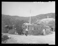 Mr. and Mrs. Louis A. Smith gardening in front of streetcar home in Sun Valley, Calif., 1950