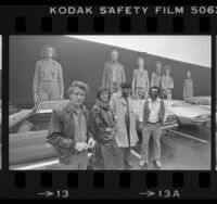 """Muralist Kent Twitchell and three of his subjects, Marta Chaffee-Stang, Alonzo Davis and Oliver Nowlin, standing before """"Six Los Angeles Artists"""" mural, 1980"""