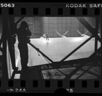 Photographer taking picture of Summa Corp engineer, George Bromley, standing on wing of the Spruce Goose airplane, 1980