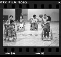 Women's wheelchair basketball team, Southern California Sunrise playing game in Los Angeles, Calif., 1980