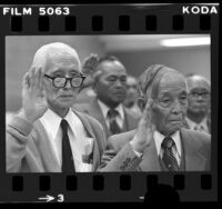 Two elderly Japanese American men taking United States citizenship oath in Los Angeles, Calif., 1980