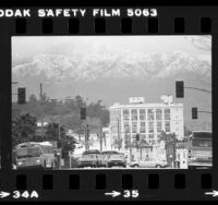 Snow covered Mt. Wilson viewed from Spring Street in downtown Los Angeles, Calif., 1980