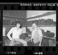 Victor Migenes and son Tito, at La Plata Cigar Co. shop in Los Angeles, Calif., 1980