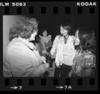 Red Cross caseworker Connie Frentzos greeting Cambodian refugees upon their arrival in Los Angeles, Calif., 1980