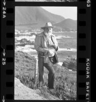 Ansel Adams, full length portrait taken along cliffs of Big Sur, Calif., 1980