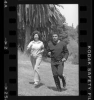 Muhammad Ali jogging with California's Secretary of State, March Fong Eu in Los Angeles, 1980